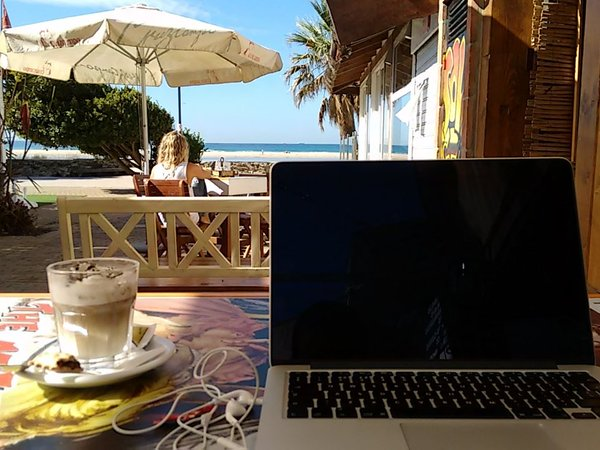 Working from a cafe next to a beach